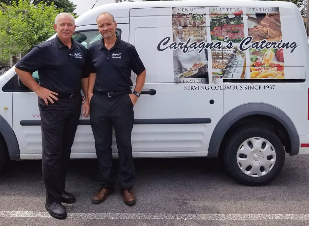 Photo of Dino & Sam Carfagna with one of their catering trucks.